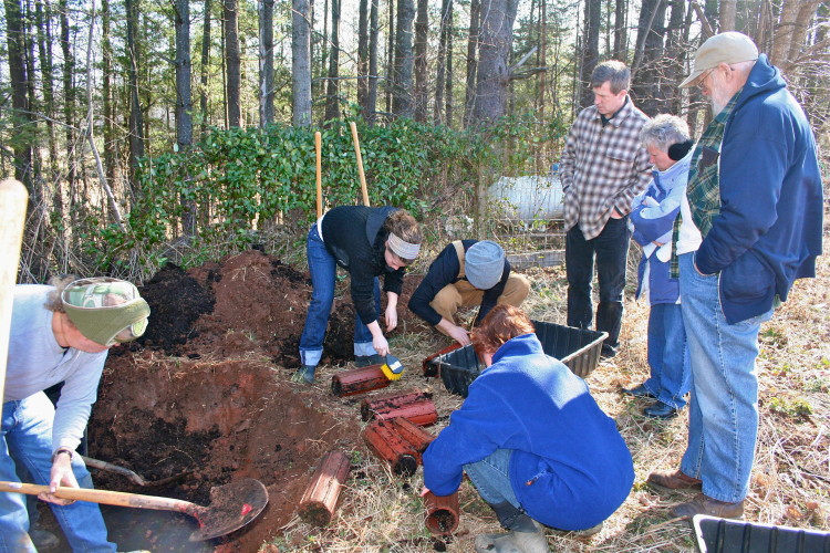 Hugh Courtney, founder of JPI, with students digging up Biodynamic preps. Photo by Lisa Reagan